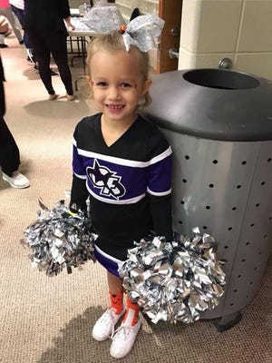 Italia McAllister is working hard at recovery after she lost her left foot in a lawnmower accident. She's pictured here before the accident as a cheerleader.