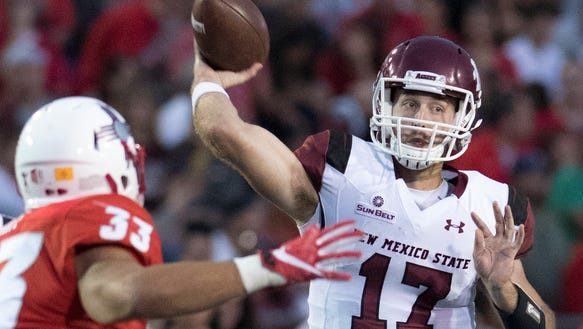 Aggies quarterback Tyler Rogers looks to get rid off