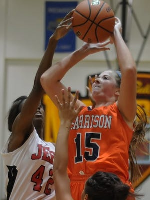 Harrison junior Erika Franscoviak struggles to get a jump shot off amid Broncho defenders in J&C Hoops action Friday night.