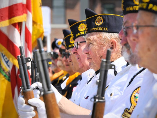 Members of the Waite Park Legion Color Guard listen to the speakers during the 2014 Memorial Day ceremony Monday at the St. Cloud VA Health Care System.