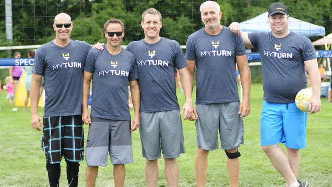 (From left to right) Mike Hanley, Chris Voss, Steve Privette, Ray Theut and Ryan Young pose in their My Turn 4 ALS shirts before a Volleygrass Tournament match.