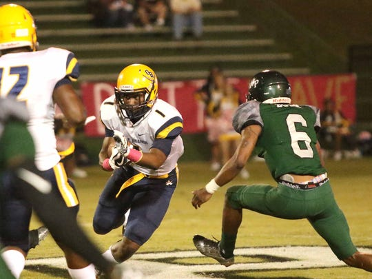 Olive Branch running back Demarcus Ware II (1) tries to avoid West Point defender EJ Bush (6) during the first half of their Friday night Oct. 13, 2017 football game in West Point, Miss.  (Special to the Clarion Ledger/Jim Lytle)