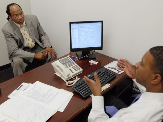 Richard Wilbern, left, was meeting with a loan officer at a Henrietta brokerage and agreed to be photographed by the Democrat and Chronicle in July 2008. The photo accompanied a story about closing on loans.