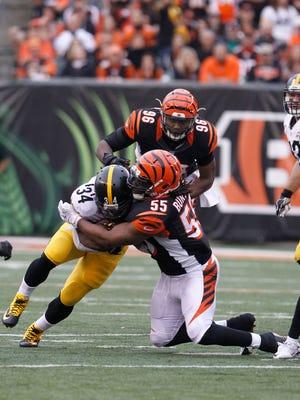 Pittsburgh Steelers running back DeAngelo Williams (34) runs the ball against Cincinnati Bengals linebacker Vontaze Burfict (55) at Paul Brown Stadium in December.