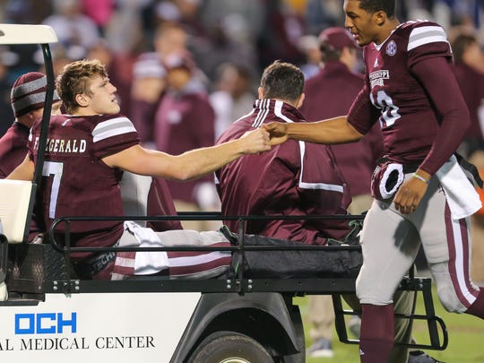 Mississippi State's Nick Fitzgerald (7) shakes hands
