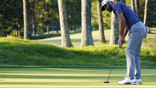 Dustin Johnson putts for a birdie on the 17th hole during the third round of the Northern Trust on Saturday.
