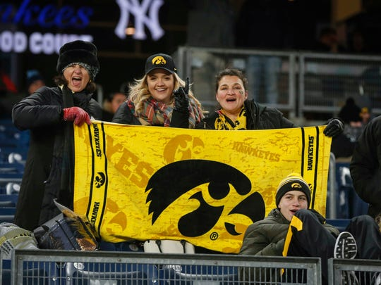 Iowa fans hold up a Tigerhawk towel prior to kickoff against Boston College during the 2017 Pinstripe Bowl at Yankee Stadium in Bronx, New York on Wednesday, Dec. 27, 2017.
