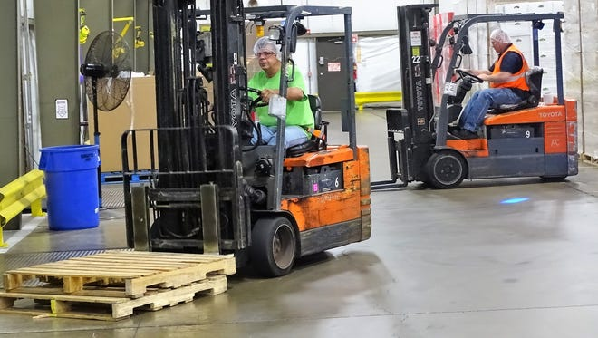 On Wednesday morning, employees of Wyandot prepare to move 15 pallets of snacks that will be sent to victims of Hurricane Maria in Puerto Rico.