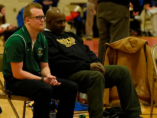 Veteran Birmingham Groves head coach Joe Smith (right) is excited about the talent on this year's wrestling team.