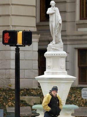 Richard Jewell, Lafayette, walks past the Marquis de Lafayette statue in below-freezing temperatures Monday, Dec. 15, 2008.