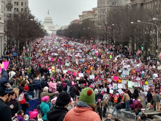 Participants in Women's March head down Pennsylvania