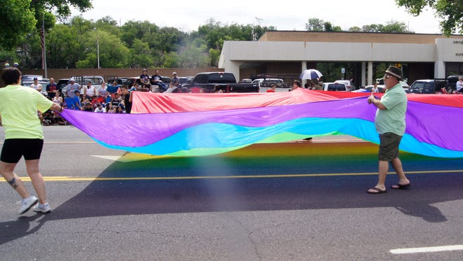 Members of PFLAG Silver City march in the July 4 Parade in Silver City.