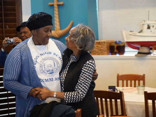 (left to right)Deloris Harris embraces fellow 1953 Howard High classmate Castella LeCompte at their class reunion luncheon.