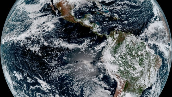 This composite color full-disk visible image is from 1:07 p.m. EDT on January 15, 2017 and was created using several of the 16 spectral channels available on the GOES-16 Advanced Baseline Imager (ABI) instrument. The image shows North and South America and the surrounding oceans.