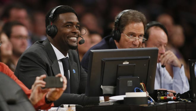 NBA commentator Chris Webber smiles during a game between the Portland Trail Blazers and Los Angeles Lakers on April 1, 2014.