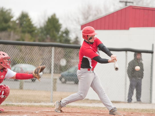 Crestview's Konnor Hickey connects with the ball during
