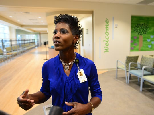 Stephania Priester of New Horizon Family Health Services gives a tour of the new Faris Road facility on Wednesday.