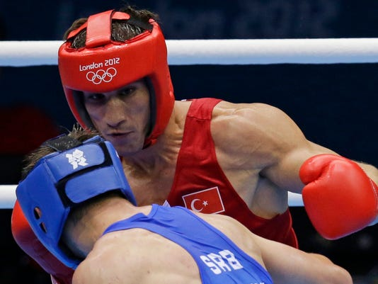 FILE - In this Aug. 2, 2012 file photo Turkey's Adem Kilicci, right, fights Serbia's Alexandar Drenovak during their men's light 75-kg boxing match at the 2012 Summer Olympics in London. The IOC said Wednesday, Feb. 1, 2017 Adem Kilicci tested positive for the anabolic steroid turinabol in reanalysis of samples from the 2012 Olympics. (AP Photo/Andrew Medichini, file)