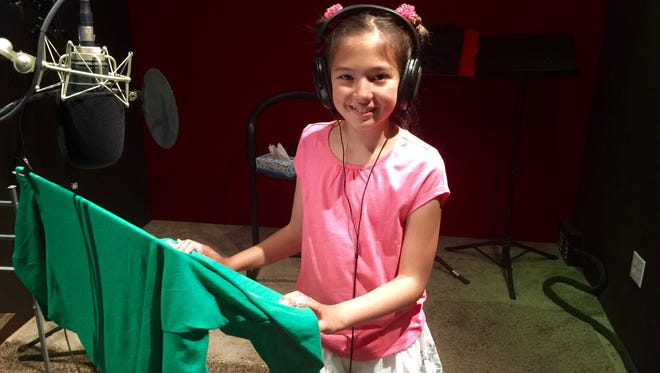 "Courtney Chu of Mount Laurel is shown in a studio recording a voice-over. Chu auditions regularly for roles in Broadway plays and recently was a part of ""Broadway Kids Against Bullying,"" which recorded a single and a video to raise funds and awareness to combat bullying."