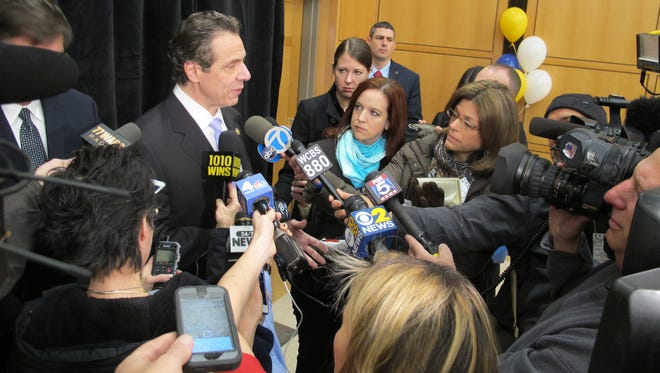 Gov. Andrew Cuomo speaks to reporters about a property tax credit proposal after a speech Wednesday at Hofstra University. He said cutting property taxes will be a top priority during his second term.
