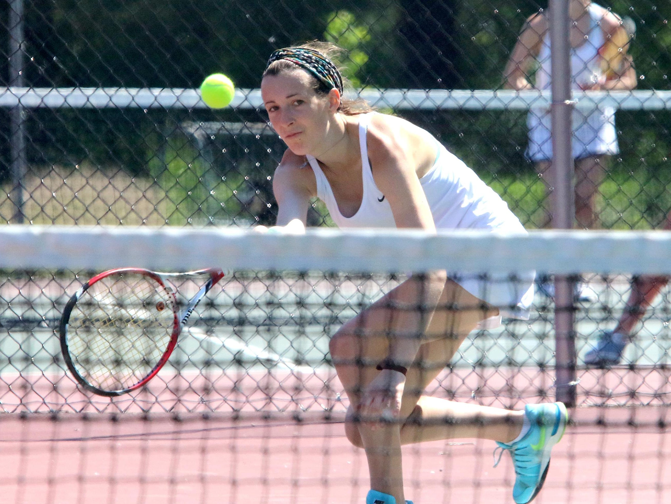 Aster O'Leary of South Burlington hits a volley during the Rebels 5-2 loss to CVU in the D1 State Finals.