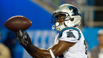 Carolina Panthers wide receiver Miles Shuler (12) tries to catch a pass during the fourth quarter against the New England Patriots at Bank of America Stadium.