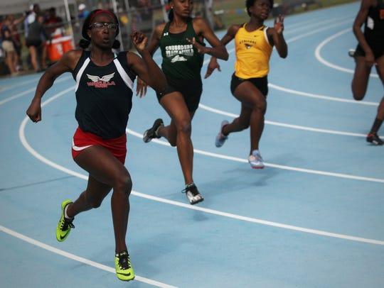 Wakulla's Ma'Asa Gay sprints the corner of her 200m