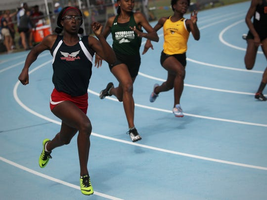 Wakulla's Ma'Asa Gay sprints the corner of her 200m run during the 2018 FHSAA State Championships at UNF in Jacksonville.