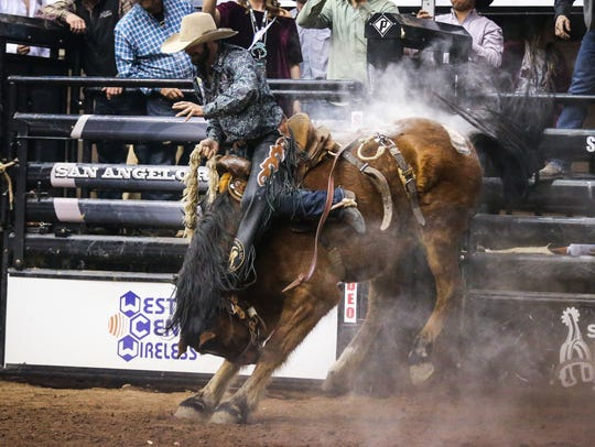 Wade Sundell rides a bronc during the 2018 San Angelo Stock Show & Rodeo.