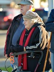 Judy James, seen with husband Wayne James, watches