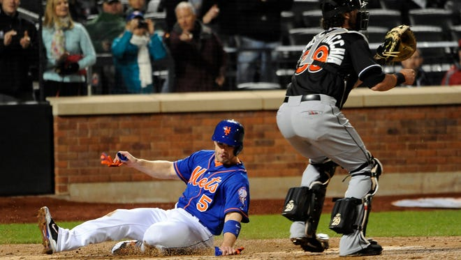 The Mets' David Wright scores on a double by Daniel Murphy in the third inning Friday at Citi Field.