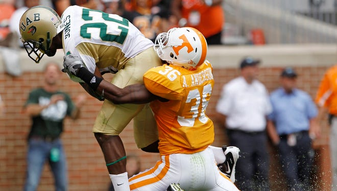 UAB wide receiver Mike Jones (22) drags Tennessee defender Anthony Anderson (36) into the end zone as Jones scores a touchdown on a 52-yard pass play in the first quarter of an NCAA college football game on Saturday, Sept. 25, 2010, in Knoxville, Tenn. (AP Photo/Mark Humphrey)