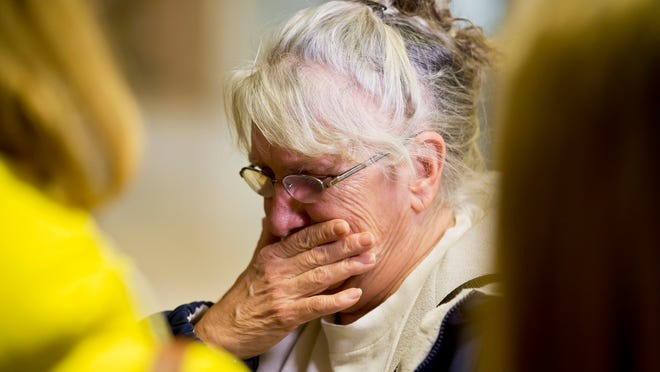 """Diane Moulton, grandmother of one of the children killed in the 1999 fire in Milton set by Eric Williams, reacts after his re-sentencing Tuesday afternoon. """"They are still dead,"""" she cried, referring to the three children and a grandmother who all perished in the fire."""