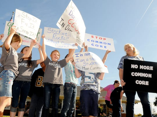 Parent Dawn Thomas (right), protests with teachers,
