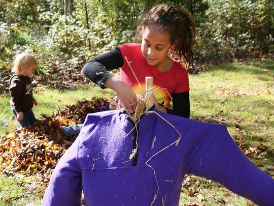 Georgia Hillsman of Cedarburg helps build a scarecrow