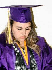 WNMU graduate Christina Arenibas sat patiently while