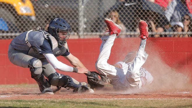Coronado catcher Zachary Dickey nearly gets the tag on El Dorado's Aaron Duran at home plate during their game Friday at El Dorado High School.