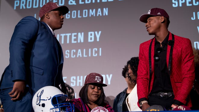 Lanier's James Foster, right, talks with Park Crossing's Tank Jenkins after they both announced they are attending Texas A&M on signing day in Montgomery, Ala., on Wednesday February 7, 2018.