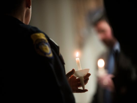 Law enforcement officers from Penn Township, West Manheim, Southwestern Regional and Hanover Borough police departments attend the Safe Home candlelight vigil to commemorate National Crime Victims' Rights Week on Wednesday night April 13, 2016 at the Hanover YWCA. Safe Home director Anne Acker also presented certificates of appreciation to the local police departments on Wednesday night.