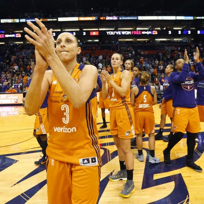 Phoenix Mercury guard Diana Taurasi (3) applauds the