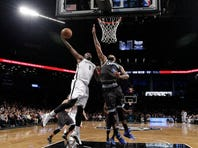 Brooklyn Nets center Andray Blatche (0) dunks over Orlando Magic forward Kyle O'Quinn (2) in the second half.