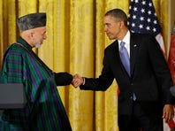 """President Barack Obama greets Afghan President Hamid Karzai Jan. 11, 2013, in the White House. """"The policy of the administration is that diplomacy should be the first option,"""" State Department spokeswoman Jen Psaki said Friday."""