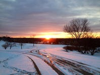 The sunrises near Forest Park, Monday morning. More frigid weather returns tomorrow. / The Enquirer/Cara Owsley