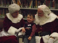 Jakob Stallions thinks hard about what he would most like for Christmas as he sits with Mrs. Santa Claus and her husband during Friday's Milk and Cookies With Santa program at the main branch of the Autauga Prattville Public Library. Jan Earnest, director of the local library network, said the annual holiday promotion was again a hit, as more than 100 children took part. Santa read booksto the youngsters, offered them a snack, and listened to their wish lists before departing for the North Pole.