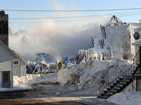 Smoke rises from the charred remains of a retirement home in L'Isle-Verte, Quebec on Thursday. At least five people were killed and about 30 others were missing after the flames raced through the three-story building in below-zero cold Fahrenheit.