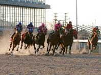 Racing at thoroughbred tracks like Turfway Park in Florence, Ky., shown in 2006 file photo, could help fill races if a purse supplement program is extended to horses running for a claiming price of at least $25,000 against allowance horses.