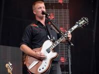 Josh Homme of Queens of the Stone Age performs during Lollapalooza 2013 in Chicago.