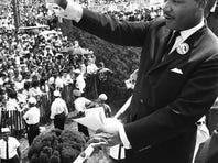US civil rights leader Martin Luther King Jr. waves to supporters on Aug. 28, 1963 from the Lincoln Memorial on the Mall in Washington D.C during the March on Washington.