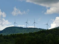 Wind turbines of the Kingdom Community Wind Project on the Lowell Mountain ridge seen from Albany looking to the west on July 11, 2013