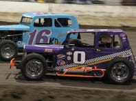 Kevin Benson drives inside Keizer's John Campos in turn three at the Salem Indoor on Saturday.